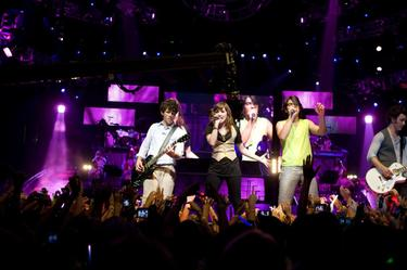 "Nick Jonas, Demi Lovato, Joe Jonas and Kevin Jonas in ""Jonas Brothers: The 3D Concert Experience."""