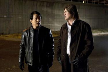 "Jackie Chan as Bob Ho and Billy Ray Cyrus as Colton James in ""The Spy Next Door."""