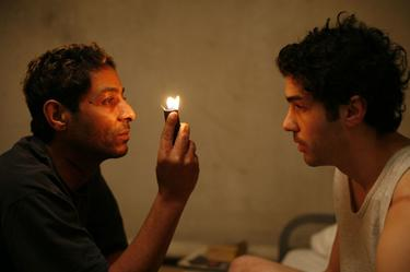 "Hichem Yacoubi as Reyeb and Tahar Rahim as Malik in ""A Prophet."""