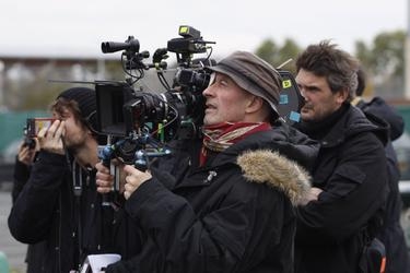 "Director Jacques Audiard on the set of ""A Prophet."""