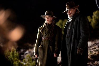 "Jeff Bridges as Rooster Cogburn and Hailee Steinfield as Mattie Ross in ""True Grit"""