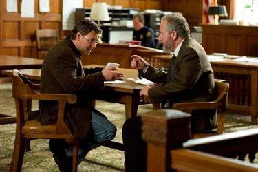 "Russell Crowe as John Brennan and Daniel Stern as Meyer Fisk in ""The Next Three Days."""