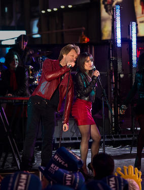 "Jon Bon Jovi as Jensen and Lea Michele as Elise in ""New Year's Eve."""