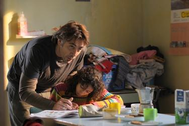 "Javier Bardem as Uxbal and Hanaa Bouchaib as Ana in ""Biutiful."""