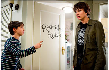 "Zachary Gordon as Greg Heffley and Devon Bostick as Rodrick in ""Diary of a Wimpy Kid 2: Rodrick Rules."""