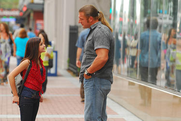 "Ariel Winter as Sally Bradstone and Paul ""Triple H"" Levesque as Ray Bradstone in ""The Chaperone ."""