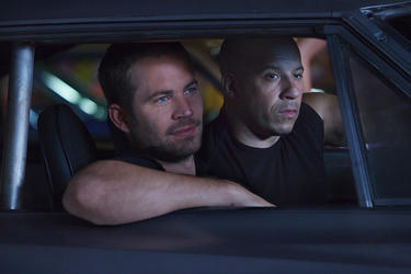 "Paul Walker and Vin Diesel in ""Fast Five."""