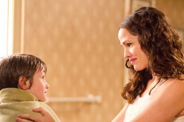 "CJ Adams as Timothy and Jennifer Garner as Cindy Green in ""The Odd Life of Timothy Green."""