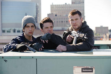 "Josh Peck, Josh Hutcherson and Chris Hemsworth in ""Red Dawn."""