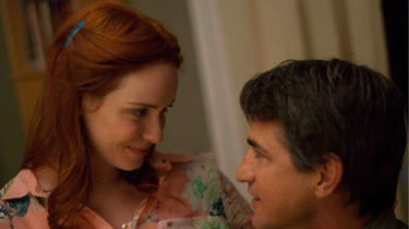 "Christina Hendricks and Dermot Mulroney in ""Struck by Lightning."""