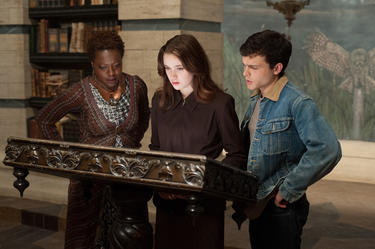 "Viola Davis as Amma, Alice Englert as Lena Duchannes and Alden Ehrenreich as Ethan Wate in ""Beautiful Creatures."""