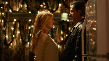 "Connie Britton and Edward Burns in ""The Fitzgerald Family Christmas."""