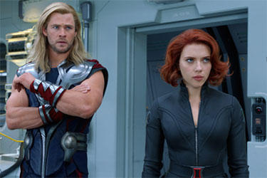 "Chris Hemsworth as Thor and Scarlett Johansson as Natasha Romanova/Black Widow in ""The Avengers."""