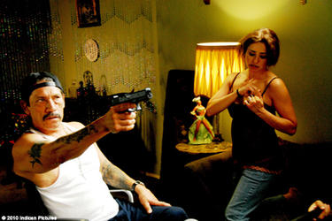 Danny Trejo as Capone and Ruth Livier as Carmen in ``Ranchero.''