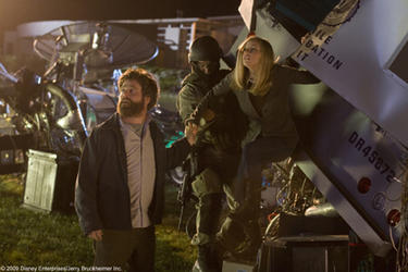 "Zach Galifianakis as Ben and Kelli Garner as Marci in ""G-Force."""