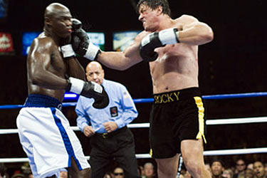 "Antonio Tarver takes a hit from Sylvester Stallone in ""Rocky Balboa."""