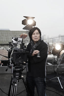 "Director Lee Chang-Dong on the set of ""Poetry."""