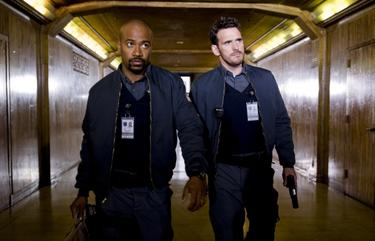 "Columbus Short and Matt Dillon in ""Armored."""