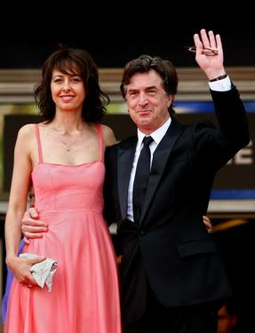 "Valerie Bonneton and Francois Cluzet at the premiere of ""In The Beginning"" during the 62nd International Cannes Film Festival."