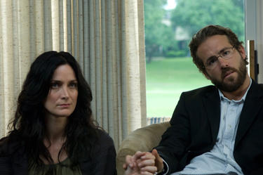 "Carrie-Anne Moss and Ryan Reynolds in ""Fireflies in the Garden."""