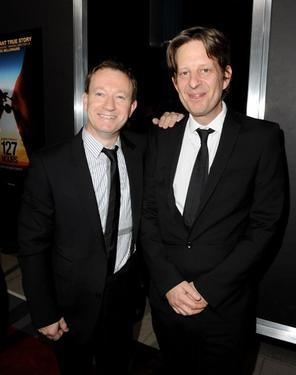 "Simon Beaufoy and producer Christian Colson at the premiere of ""127 Hours."""