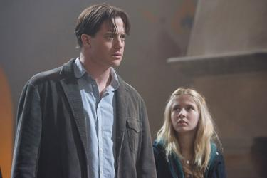 "Brendan Fraser as Mo and Eliza Hope Bennett as Meggie in ""Inkheart."""