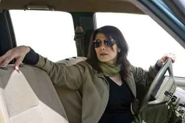 "Hiam Abbass as Driver in ""The Limits of Control."""