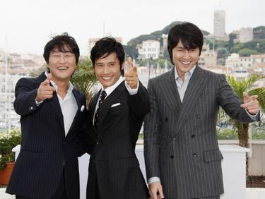 "Song Kang-Ho, Lee Byung-Hun and Jung Woo-Sung at the photocall of ""The Good, the Bad, the Weird' during the 61st International Cannes Film Festival."