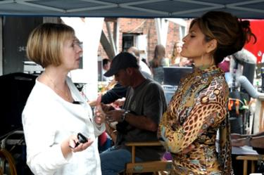 "Director Diane English and Eva Mendes on the set of ""The Women."""