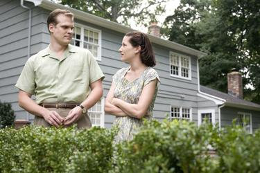 "David Harbour as Shep Campbell and Kathryn Hahn as Milly Campbell in ""Revolutionary Road."""