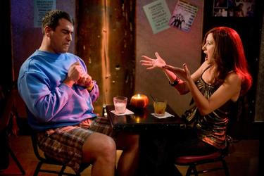 "Rob Riggle as Peter Selleck and Kathryn Hahn as Babs Merrick in ""The Goods: Live Hard, Sell Hard."""