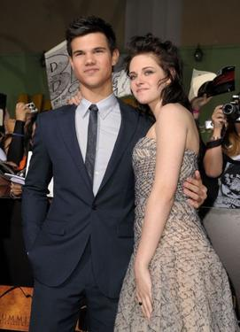 "Taylor Lautner and Kristen Stewart at the California premiere of ""The Twilight Saga: New Moon."""