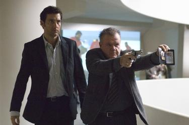 "Clive Owen as Louis Salinger and Jack McGee as Detective Bernie Ward in ""The International."""
