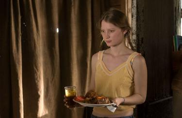 "Mia Wasikowska as Pamela in ""That Evening Sun."""