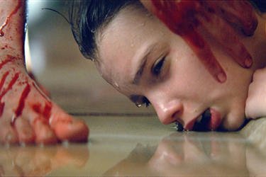 "Kodi Smit-McPhee as Owen in ""Let Me In"""