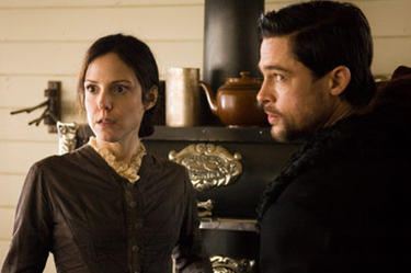"Mary-Louise Parker and Brad Pitt in ""The Assassination of Jesse James by the Coward Robert Ford."""