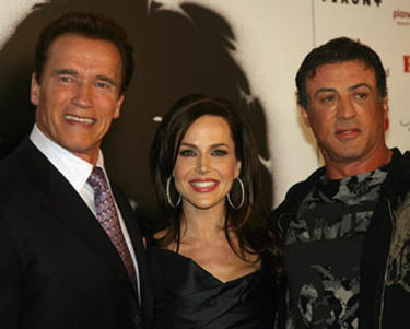 "Arnold Schwarzenegger, Julie Benz and actor Sylvester Stalllone at the Las Vegas premiere of ""Rambo."""