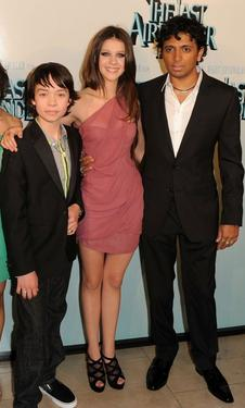 "Noah Ringer, Nicola Peltz and M. Night Shyamalan at the New York premiere of ""The Last Airbender."""
