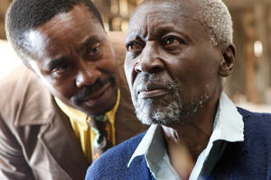 Vusi Kunene as Mr. Kipruto and Oliver Litondo as Kimani N'gan'ga Maruge in ``The First Grader.''