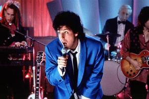 "Adam Sandler stars as Robbie in ""The Wedding Singer."""