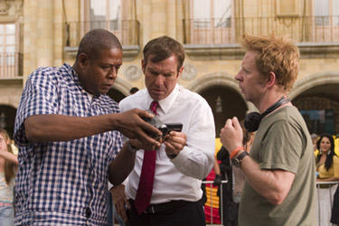 "Forest Whitaker, Dennis Quaid and director Pete Travis in ""Vantage Point."""
