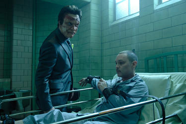 "Dominic West as Jigsaw and Doug Hutchison as Loony Bin Jim in ""Punisher: War Zone."""