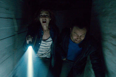 Devin Kelley as Amanda and Jonathan Sadowski as Paul in ``Chernobyl Diaries.''