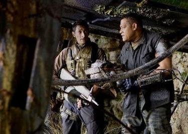 "Adrien Brody as Royce and Laurence Fishburne as Noland in ""Predators."""