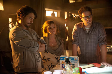 "James Franco, Emma Watson and Seth Rogan in ""This is The End."""
