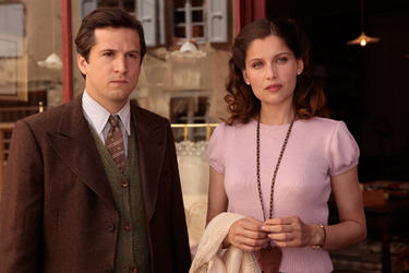 "Guillaume Canet and Laetitia Casta in ""War of the Buttons."""