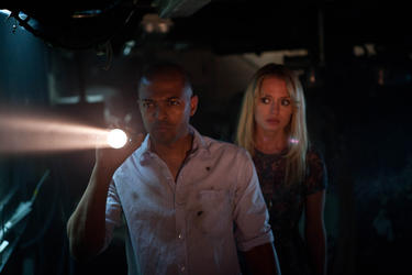 "Noel Clarke and Laura Haddock in ""Storage 24."""