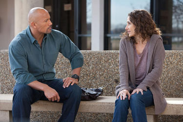"Dwayne Johnson and Melina Kanakaredes in ""Snitch."""