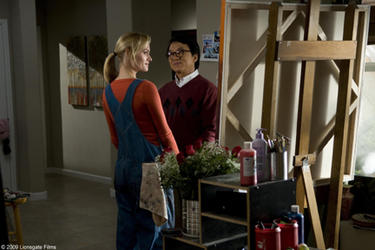 "Amber Valletta as Gillian and Jackie Chan as Bob Ho in ""The Spy Next Door."""