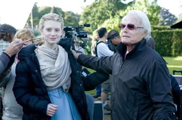 "Mia Wasikowska and Richard Zanuck on the set of ""Alice in Wonderland in Disney Digital 3D."""